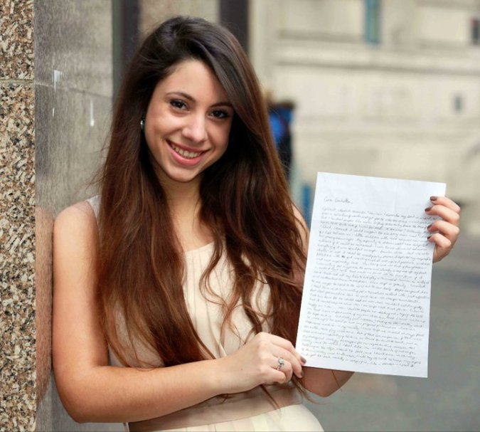 Photo taken for an article for The Sun, holding the original letter I sent